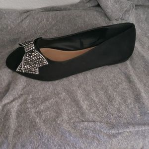 Black studded bow faux suede flats